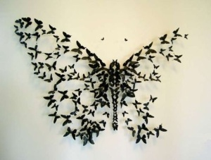butterfly made out of crushed beer cans